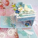 Гамма нежная голубая, в работе использовала скрап бумагу, кружево, много цветочков.